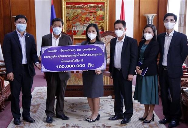 Provincia laosiana apoya esfuerzos de respuesta al COVID-19 en Vietnam hinh anh 1
