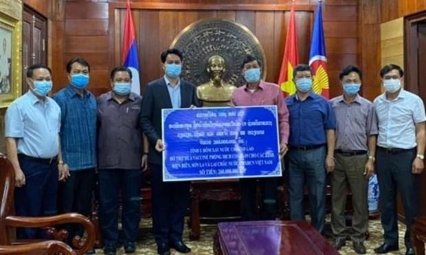 Laos ayuda a localidades vietnamitas en combate contra COVID-19 hinh anh 1