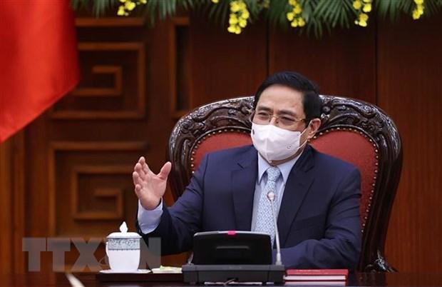 Optimista premier de Vietnam sobre resultados de lucha antiepidemica hinh anh 1