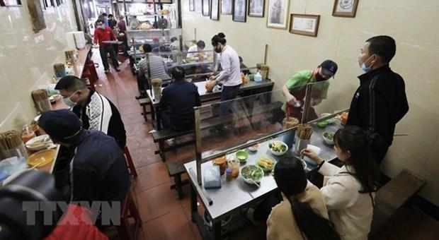 Hanoi reabre hoy servicios en peluqueria y restaurantes hinh anh 1