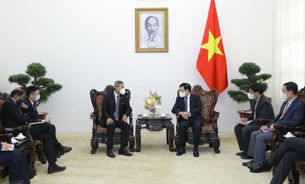 Vietnam aspira a cooperar con Singapur en acceso a tecnologias y vacunas contra el COVID-19 hinh anh 1