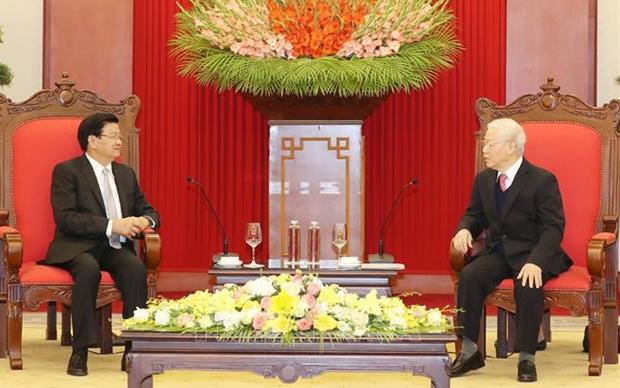 Visita del maximo dirigente de Laos a Vietnam fomentara relaciones bilaterales de confianza hinh anh 1