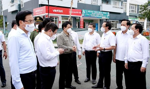 Premier averigua eficiencia de lucha antipandemica en Ciudad Ho Chi Minh hinh anh 1