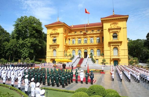 Presidente de Vietnam da la bienvenida al maximo dirigente de Laos hinh anh 2