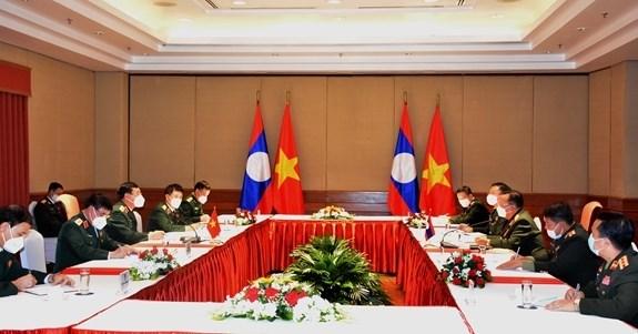 Promueven cooperacion entre Vietnam y Laos en defensa hinh anh 1
