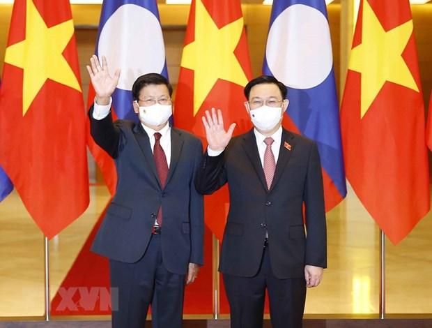 Alaban relaciones de amistad, solidaridad y cooperacion entre Vietnam y Laos hinh anh 1