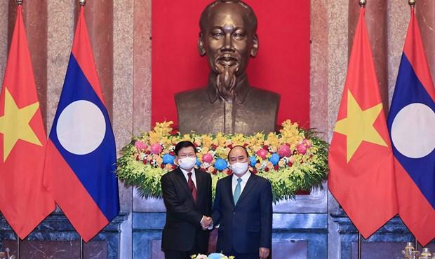 Presidente vietnamita se reune con maximo dirigente de Laos hinh anh 1