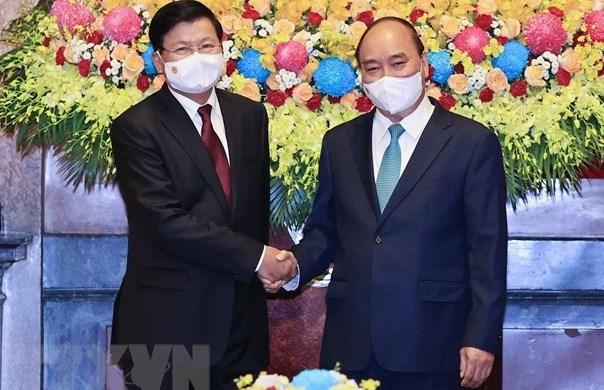 Visita del maximo dirigente de Laos a Vietnam: hito historico para ambos pueblos hinh anh 1