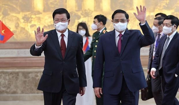Visita del maximo dirigente de Laos a Vietnam: hito historico para ambos pueblos hinh anh 2