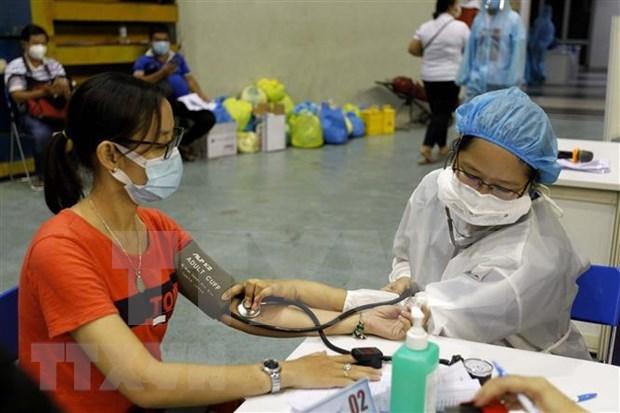 Vietnam realiza cribas a gran escala para vacunacion masiva contra COVID-19 hinh anh 1