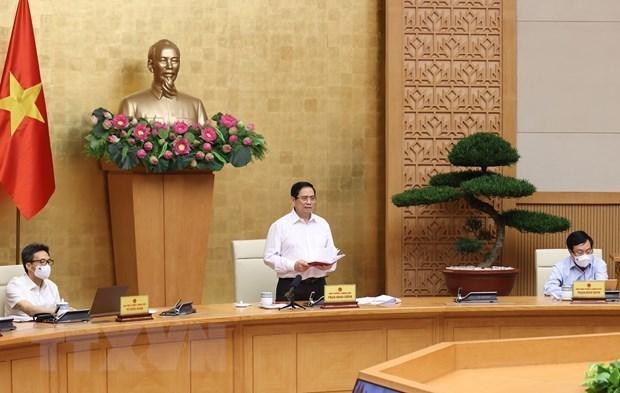 Urge premier vietnamita a controlar y repeler brotes del COVID-19 en localidades surenas hinh anh 1