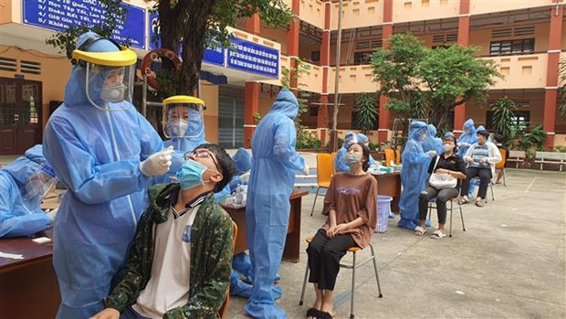 Contabiliza Vietnam 21 mil 312 portadores del COVID-19 en total hinh anh 1
