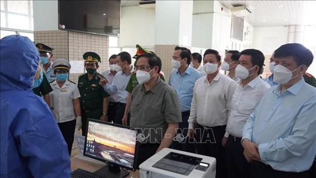 Premier insta a reforzar control del COVID-19 en Tay Ninh y Long An hinh anh 1