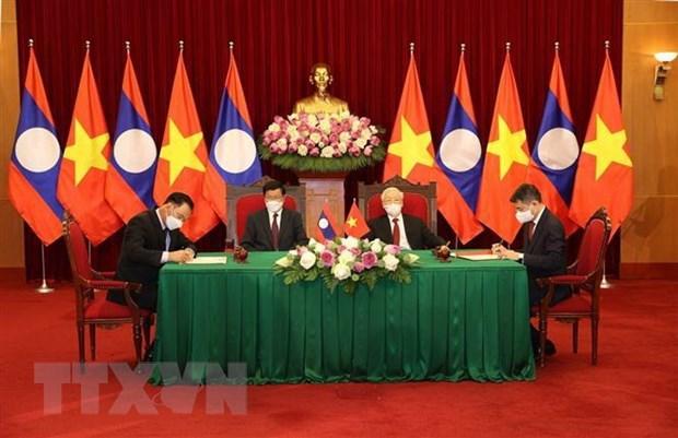 Destaca periodico Pathetlao la solidaridad especial y cooperacion integral entre Vietnam y Laos hinh anh 1