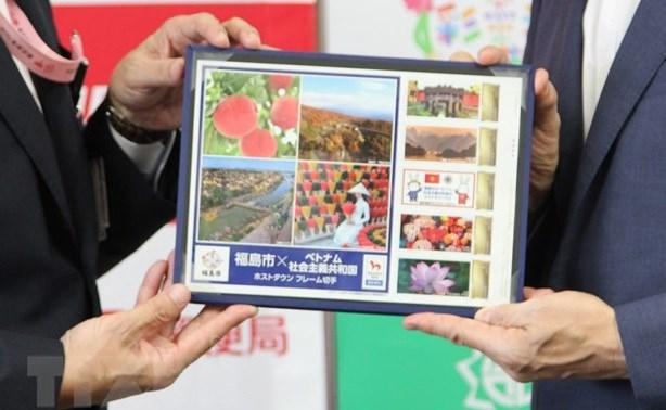 Fukushima emite sellos especiales con imagenes vietnamitas en ocasion de Juegos Olimpicos hinh anh 1