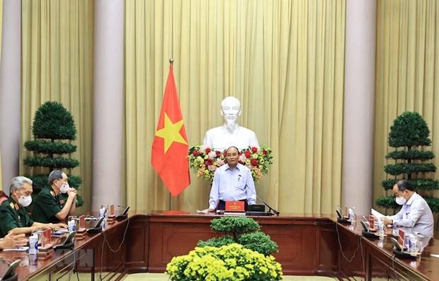 Presidente de Vietnam destaca actividades de apoyo a invalidos de guerra y familias de martires hinh anh 1