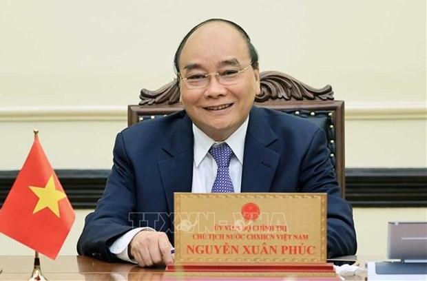 Presidente de Vietnam rinde homenaje a las personas con meritos revolucionarios hinh anh 1