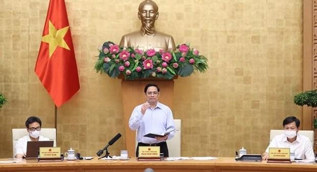 Primer Ministro vietnamita insta a tomar nuevas soluciones en la lucha contra el COVID-19 hinh anh 1