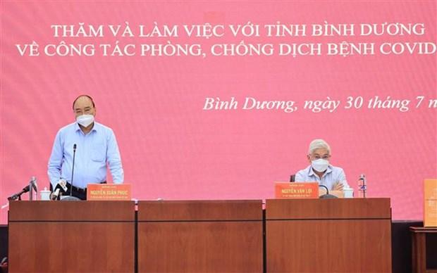 Presidente vietnamita visita provincia surena golpeada por COVID-19 hinh anh 1