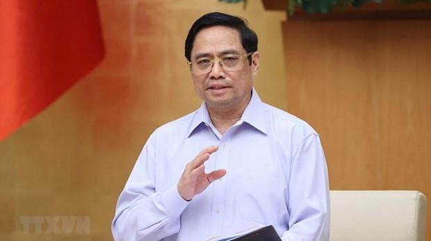 Primer Ministro vietnamita alaba esfuerzos en la vanguardia de la lucha contra el COVID-19 hinh anh 2