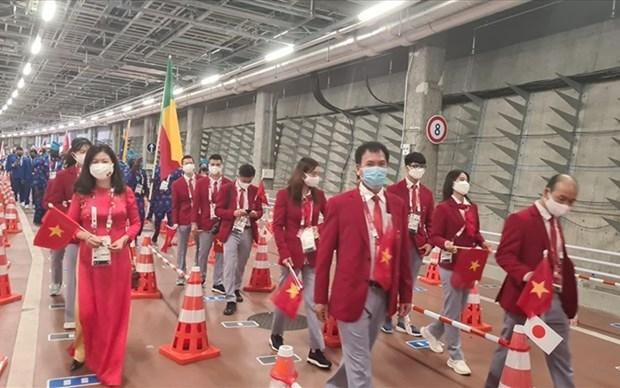 Regresa delegacion vietnamita de los Juegos Olimpicos de Tokio 2020 hinh anh 1