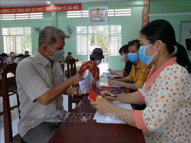 Buscan mejorar asistencia a personas afectadas por COVID-19 en Vietnam hinh anh 1