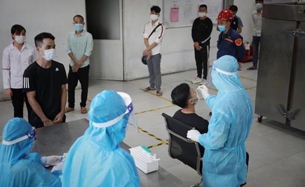 Primer Ministro de Vietnam insta a intensificar medidas preventivas del COVID-19 hinh anh 1