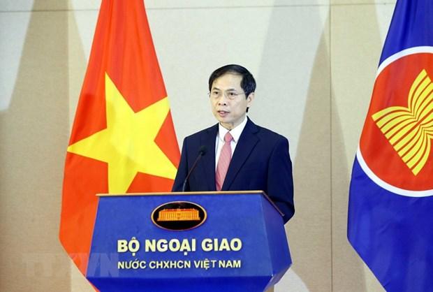 Celebran en Hanoi acto de saludo a bandera de ASEAN hinh anh 2