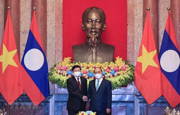 Visita del presidente de Vietnam a Laos evidencia solidaridad especial binacional hinh anh 1