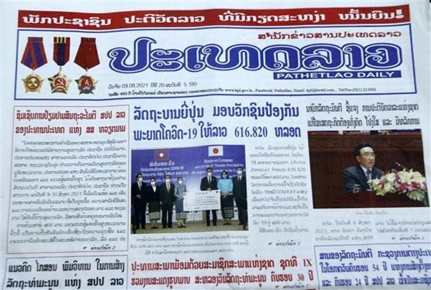 Prensa de Laos aprecia significado de visita oficial del presidente de Vietnam hinh anh 1