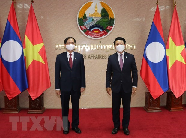 Promueven cooperacion entre cancillerias de Vietnam y Laos hinh anh 1