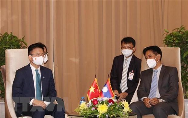Fomentan Vietnam y Laos cooperacion en comercio y asuntos judiciales hinh anh 2