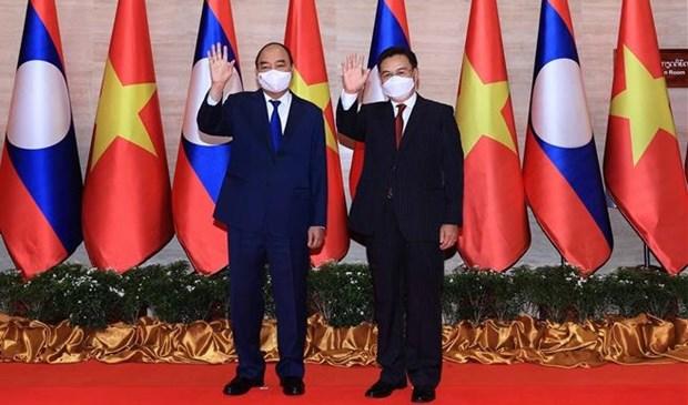 Visita oficial del presidente vietnamita a Laos acapara portadas de prensa laosiana hinh anh 1