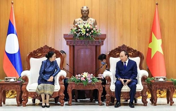 Vietnam concede gran importancia a nexos con Laos, segun presidente Nguyen Xuan Phuc hinh anh 2