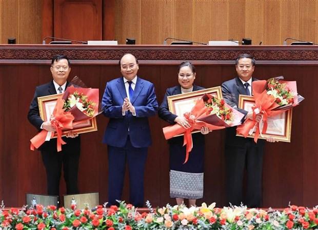 Vietnam concede gran importancia a nexos con Laos, segun presidente Nguyen Xuan Phuc hinh anh 5