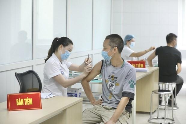 Primer ministro de Vietnam orienta autorizacion de vacuna autoctona contra el COVID-19 hinh anh 1