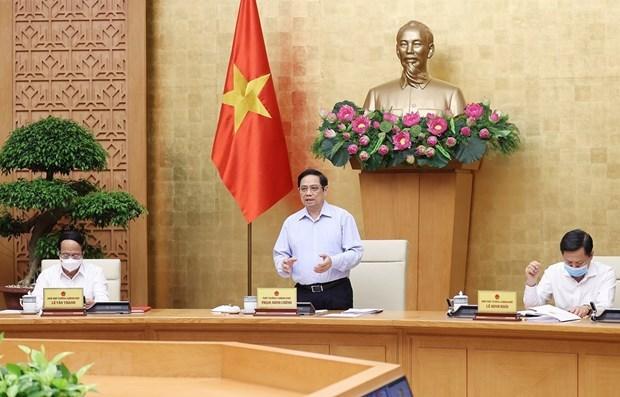 Gobierno de Vietnam analiza situacion socioeconomica y respuesta al COVID-19 hinh anh 1