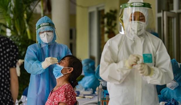 Hanoi realiza pruebas del COVID-19 con metodo RT-PCR a 1,3 millones de personas hinh anh 1