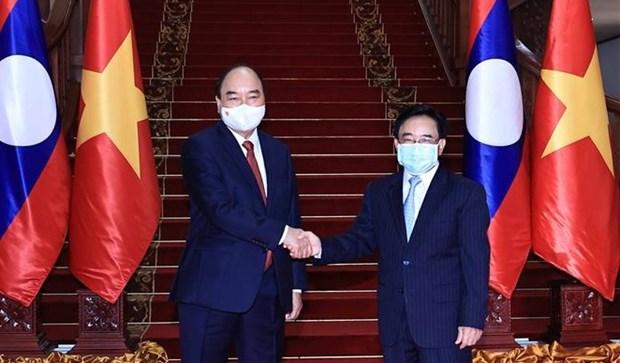 Visita oficial del presidente vietnamita a Laos refleja gran amistad y solidaridad bilateral hinh anh 1