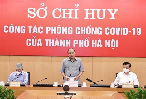 Alienta presidente a fuerzas participantes en lucha contra COVID-19 en Hanoi hinh anh 2