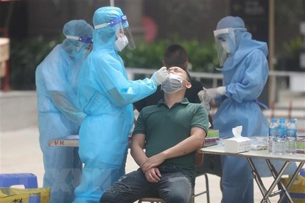 Vietnam registra leve disminucion de casos del COVID-19 hinh anh 1