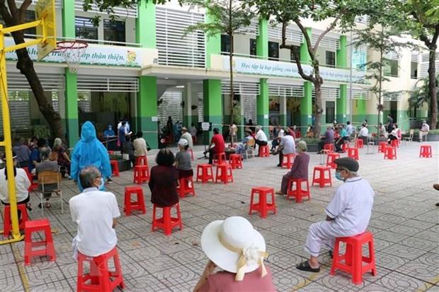 Vietnam registra nueve mil 716 casos nuevos del COVID-19 hinh anh 1