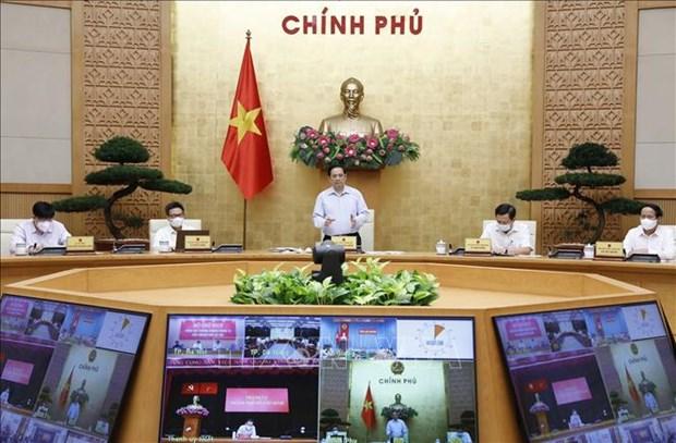 Gobierno de Vietnam evalua implementacion de medidas contra el COVID-19 hinh anh 1