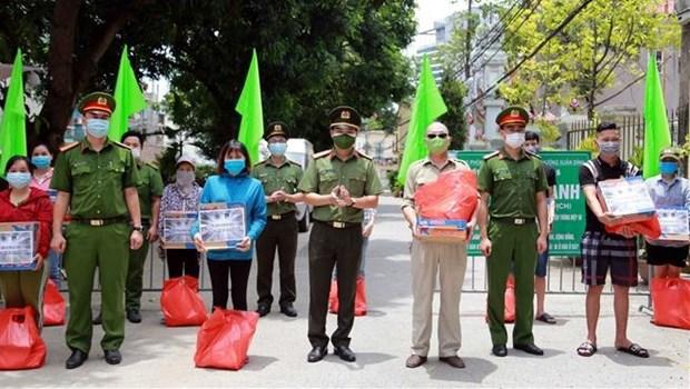 Vietnam extiende ayuda a personas con dificultades causadas por el COVID-19 hinh anh 1