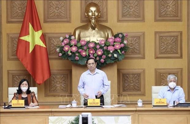 Primer ministro de Vietnam anima a pobladores a ser activos en lucha contra COVID-19 hinh anh 1