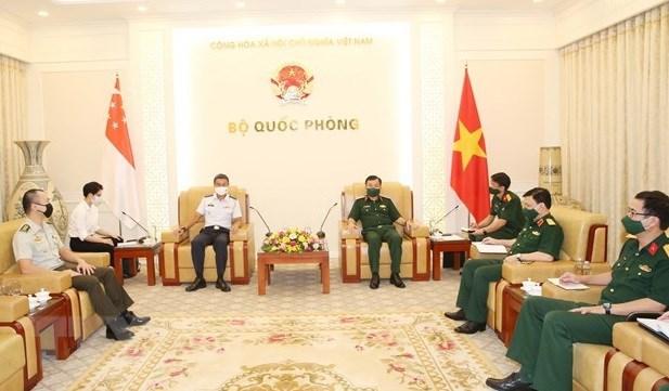 Vietnam busca cooperar con Singapur en produccion de vacunas contra el COVID-19 hinh anh 1