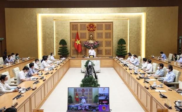 Primer ministro de Vietnam insta a garantizar el bienestar social para la poblacion en medio del COVID-19 hinh anh 1