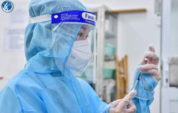 Ciudad Ho Chi Minh considera vacunar a personas de 12 a 18 anos de edad hinh anh 1