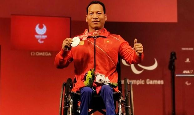 Halterofilo vietnamita cosecha medalla de plata en Juegos Paralimpicos de Tokio 2020 hinh anh 1