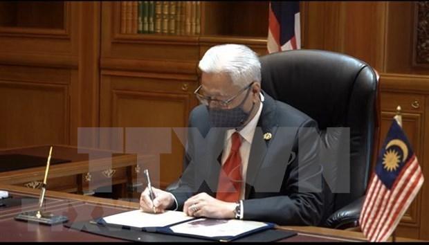 Politicos malasios se unen en lucha pandemica hinh anh 1